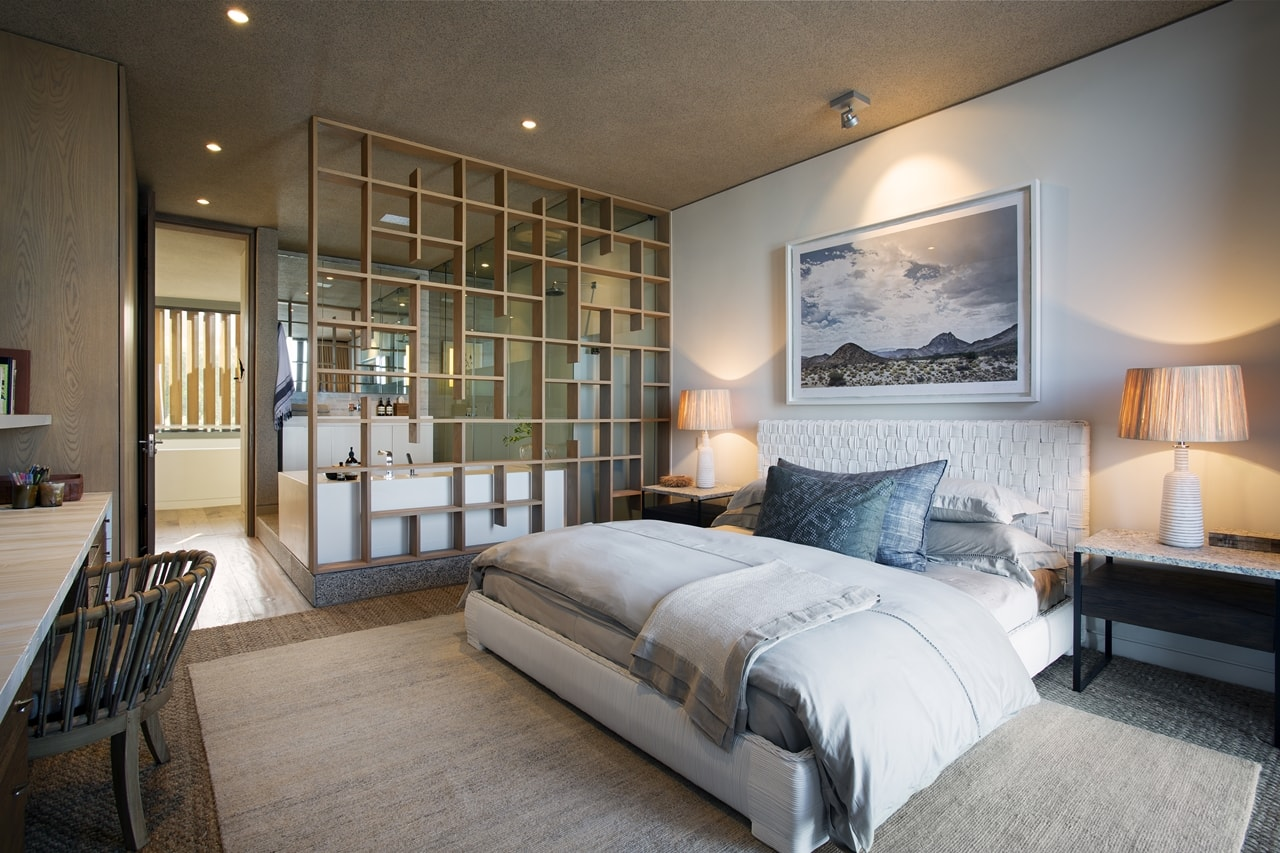 Bright bedroom in modern home with wooden facade by SAOTA