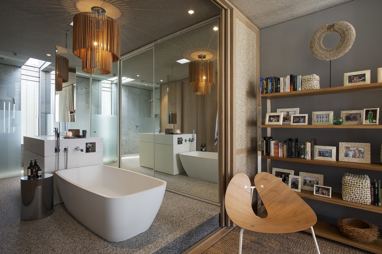 Contemporary bathroom in modern home with wooden facade by SAOTA