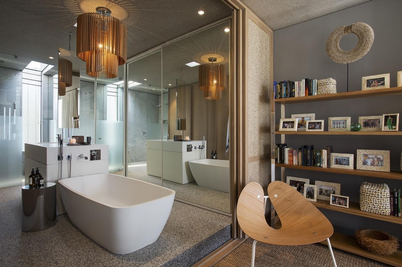 Contemporary bathroom in modern home with wooden facade by SAOTA