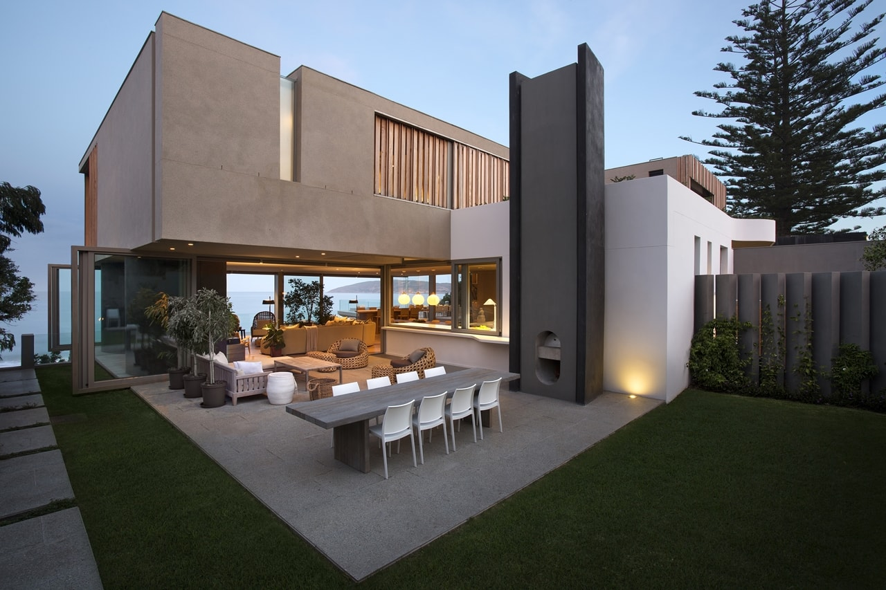 Outdoor terrace and modern home with wooden facade by SAOTA