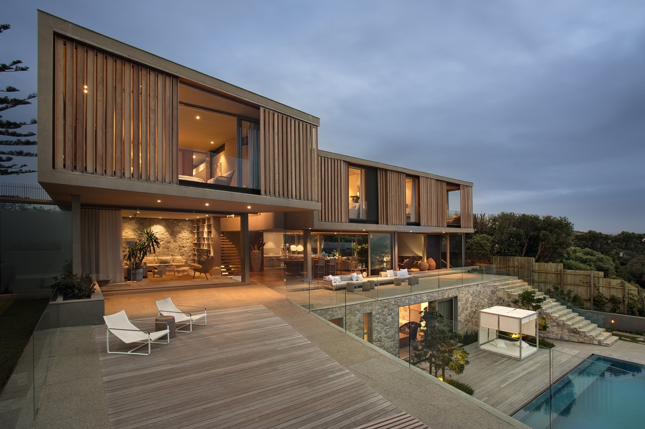 Terrace view of modern home with wooden facade by SAOTA