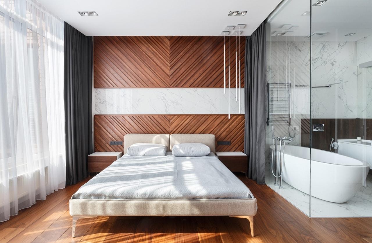 Modern bedroom and bathroom with glass wall by SVOYA studio