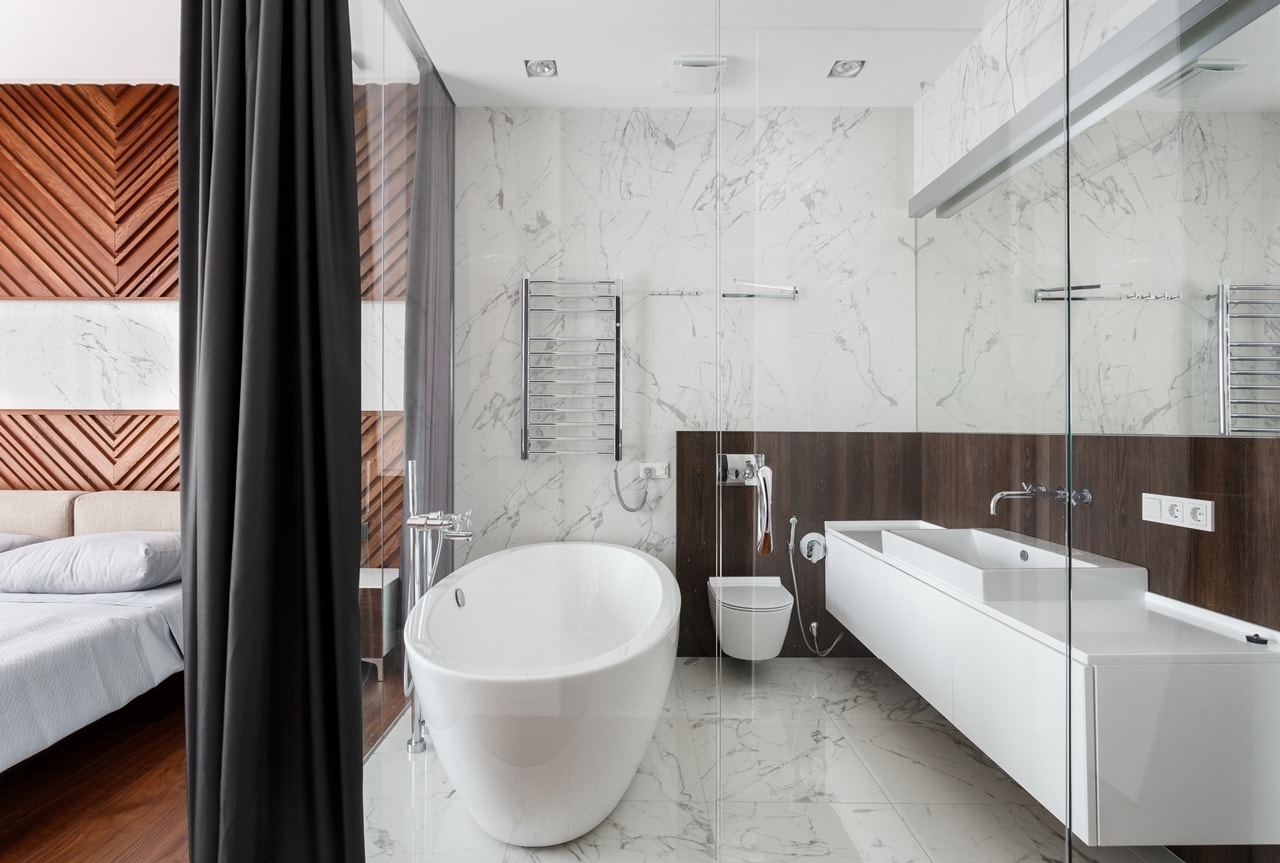 Modern bathroom with marble and glass walls by SVOYA studio