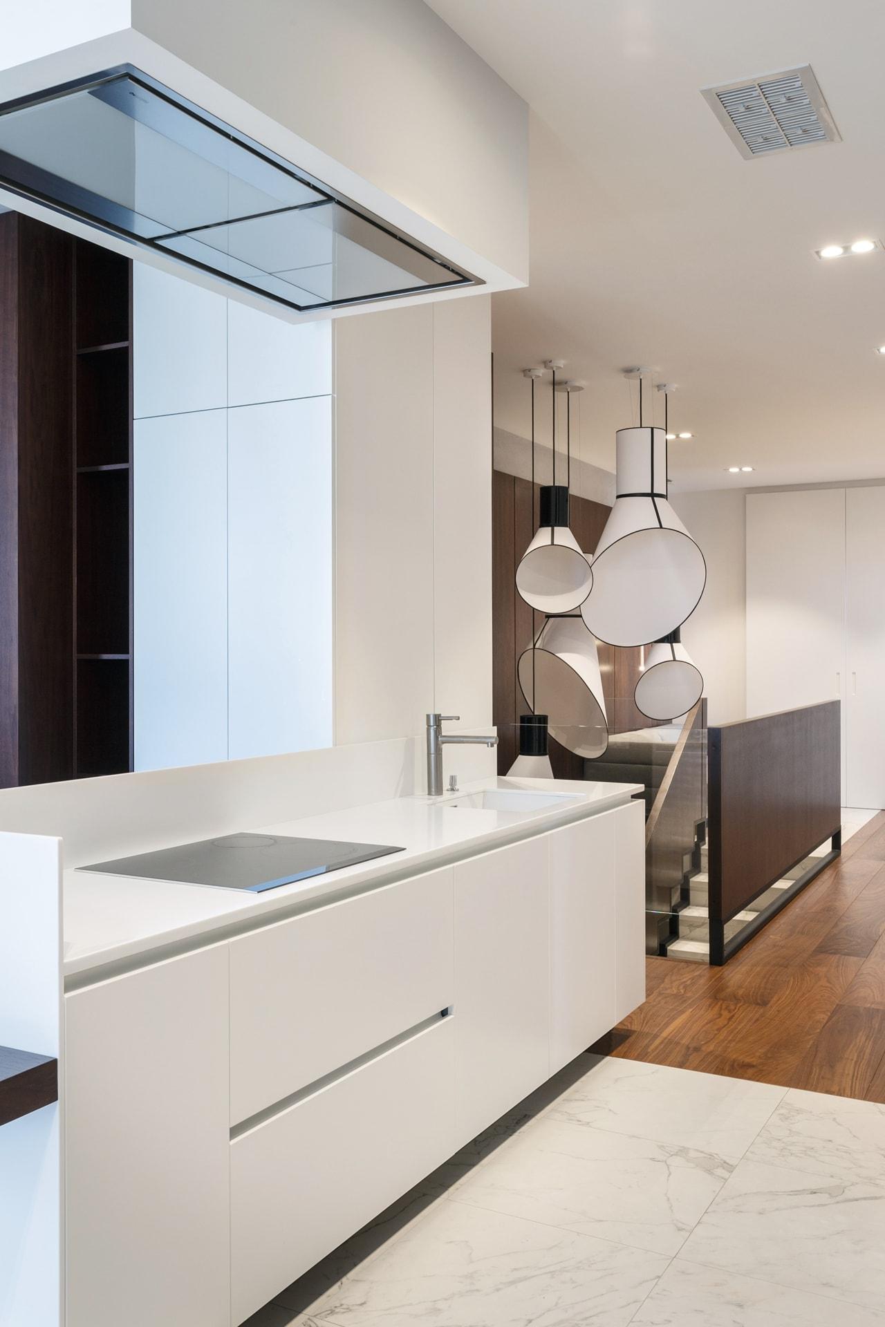 Modern white kitchen by SVOYA