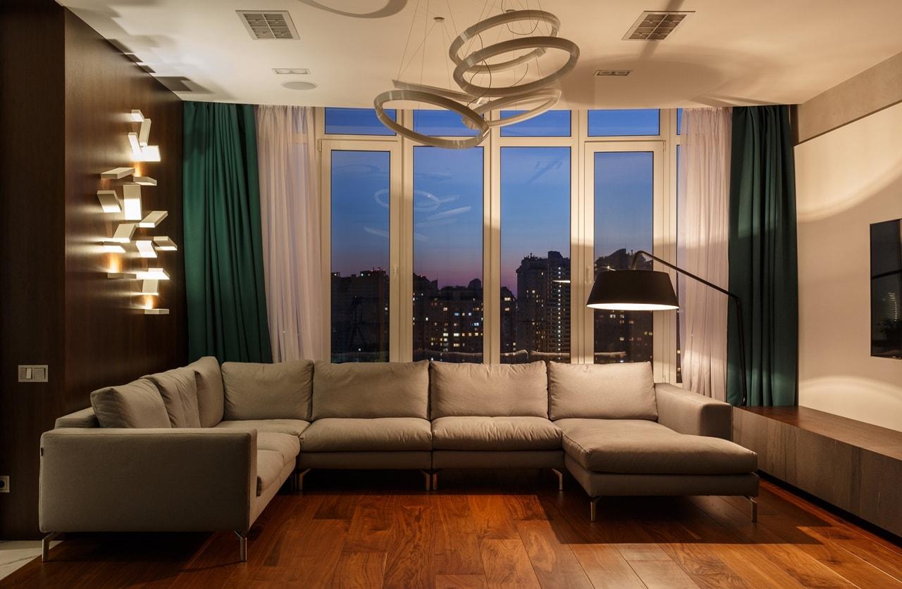 Modern living room by SVOYA at night