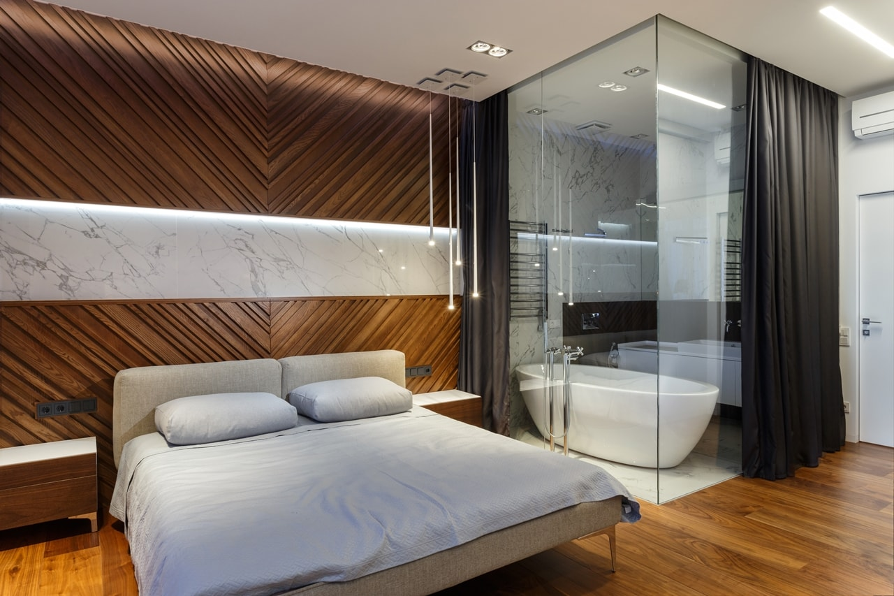Modern bedroom with glass walls to the bathroom