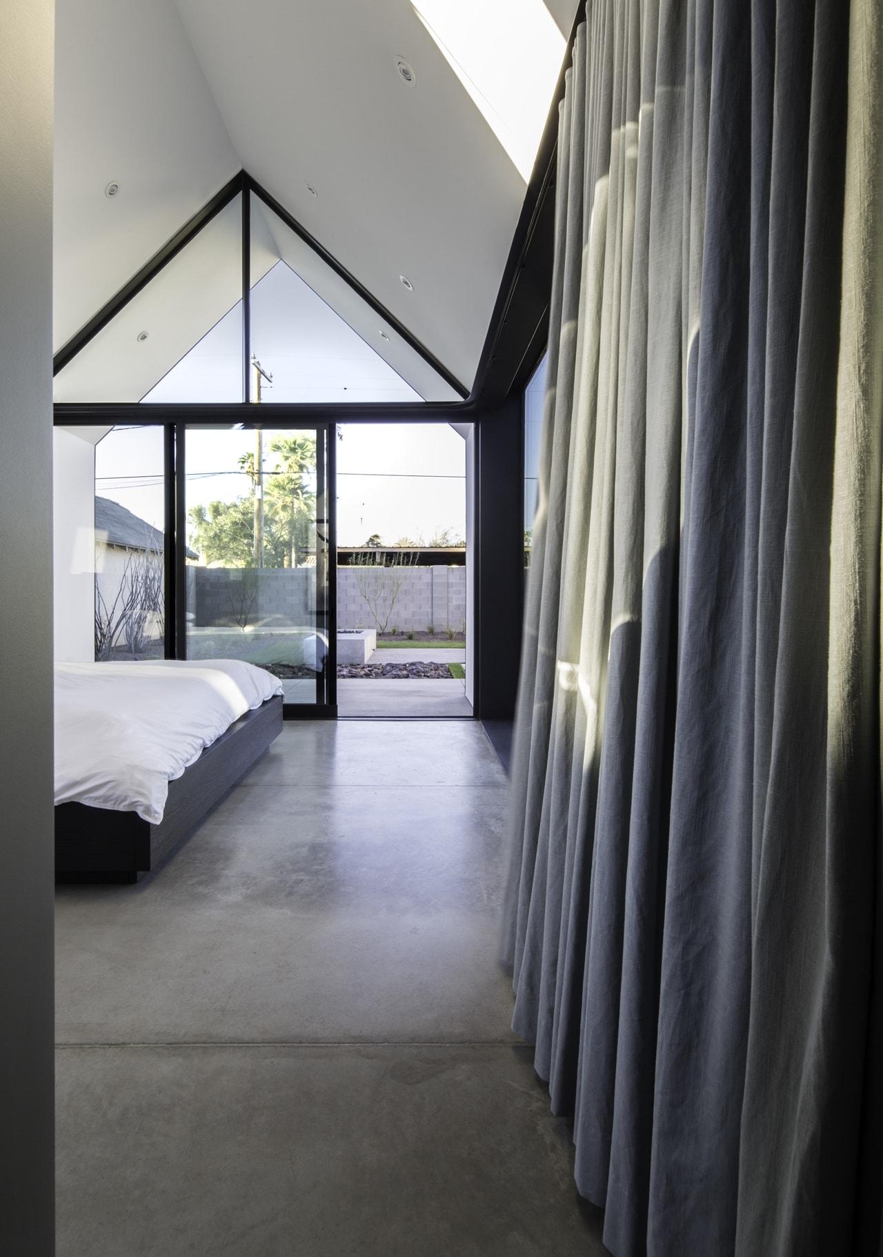 Modern bedroom renovated by Chen + Suchart Studio