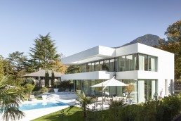 Modern home with white concrete and glass walls as showcased in best exterior house design ideas