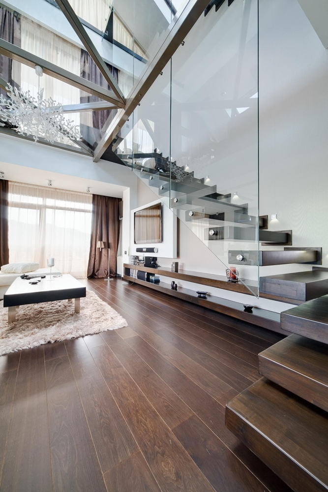 Modern staircase and glass floor in triplex apartment