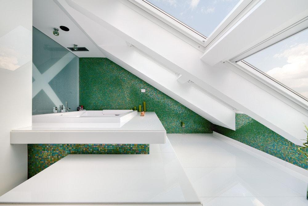 Modern attic bathroom with green walls