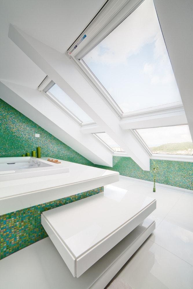 Roof windows in modern white bathroom