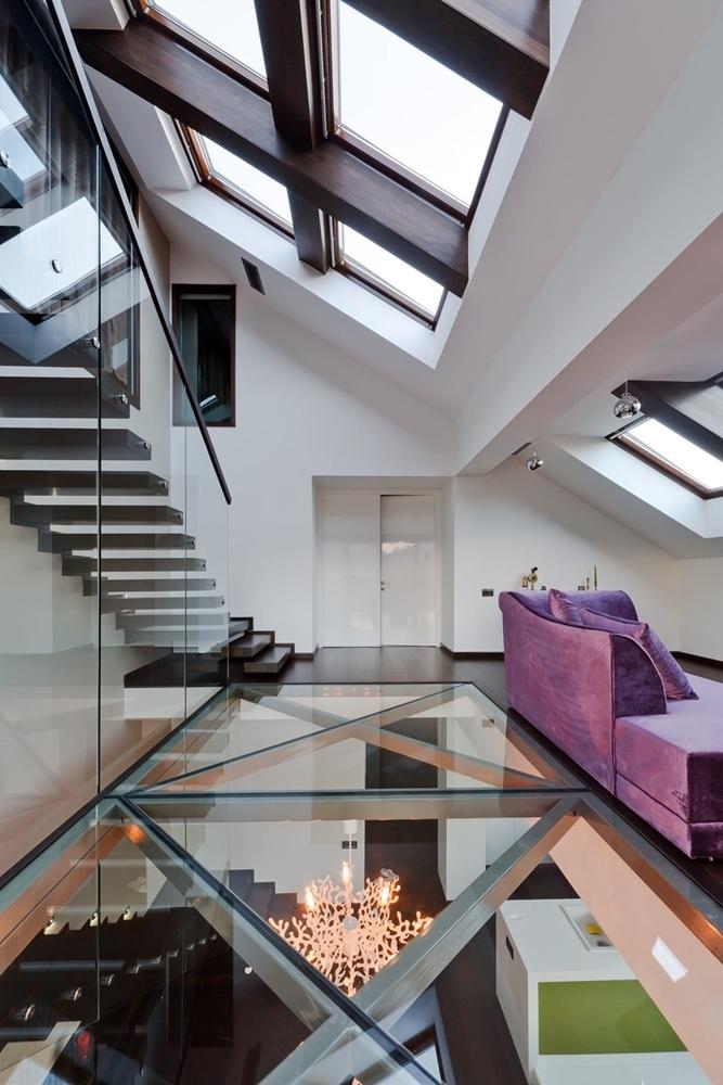 Glass floor design in modern triplex apartment
