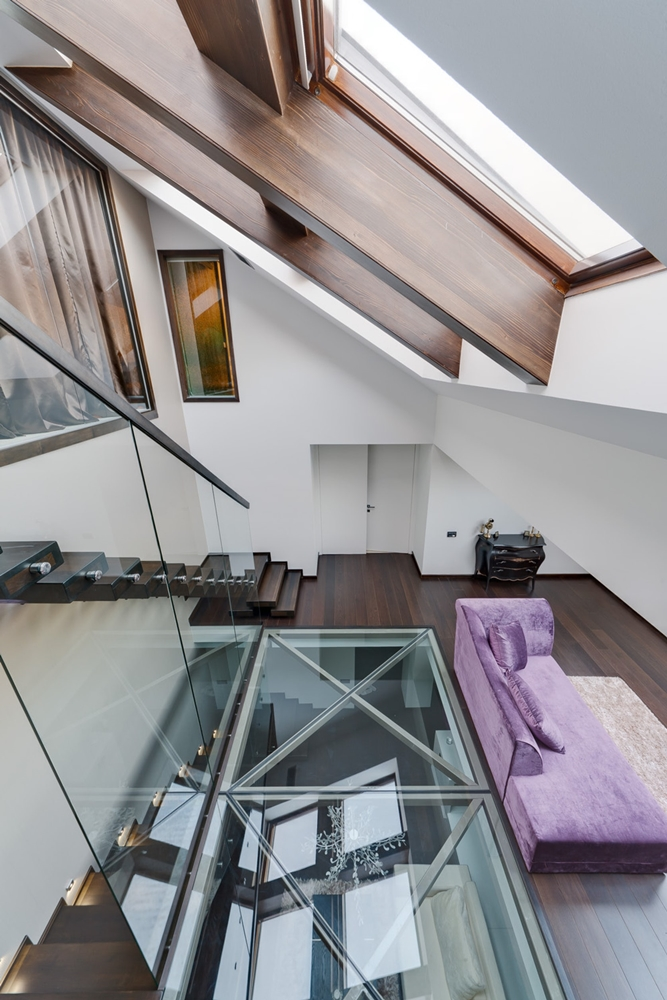 Roof windows and glass floor design as seen from the attic