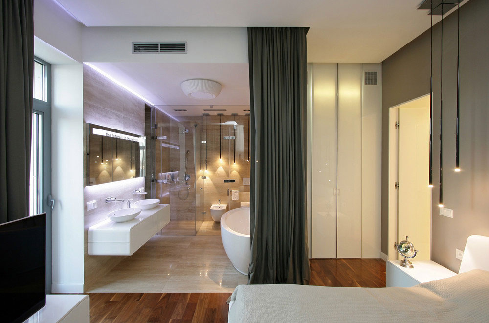 Small modern bathroom with glass room diciders
