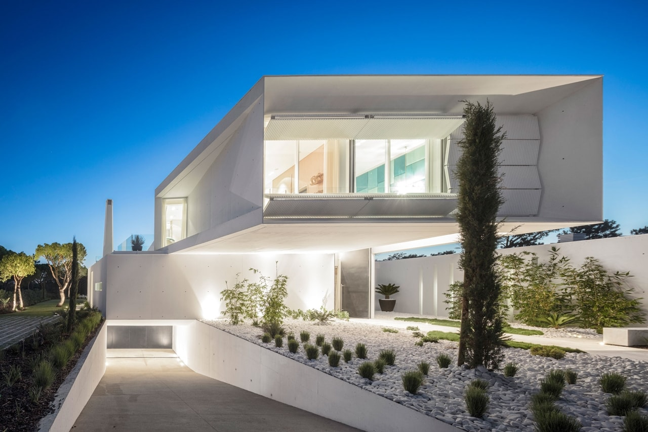 Front facade design of an imposing modern house by - Home exterior and interior designs ...