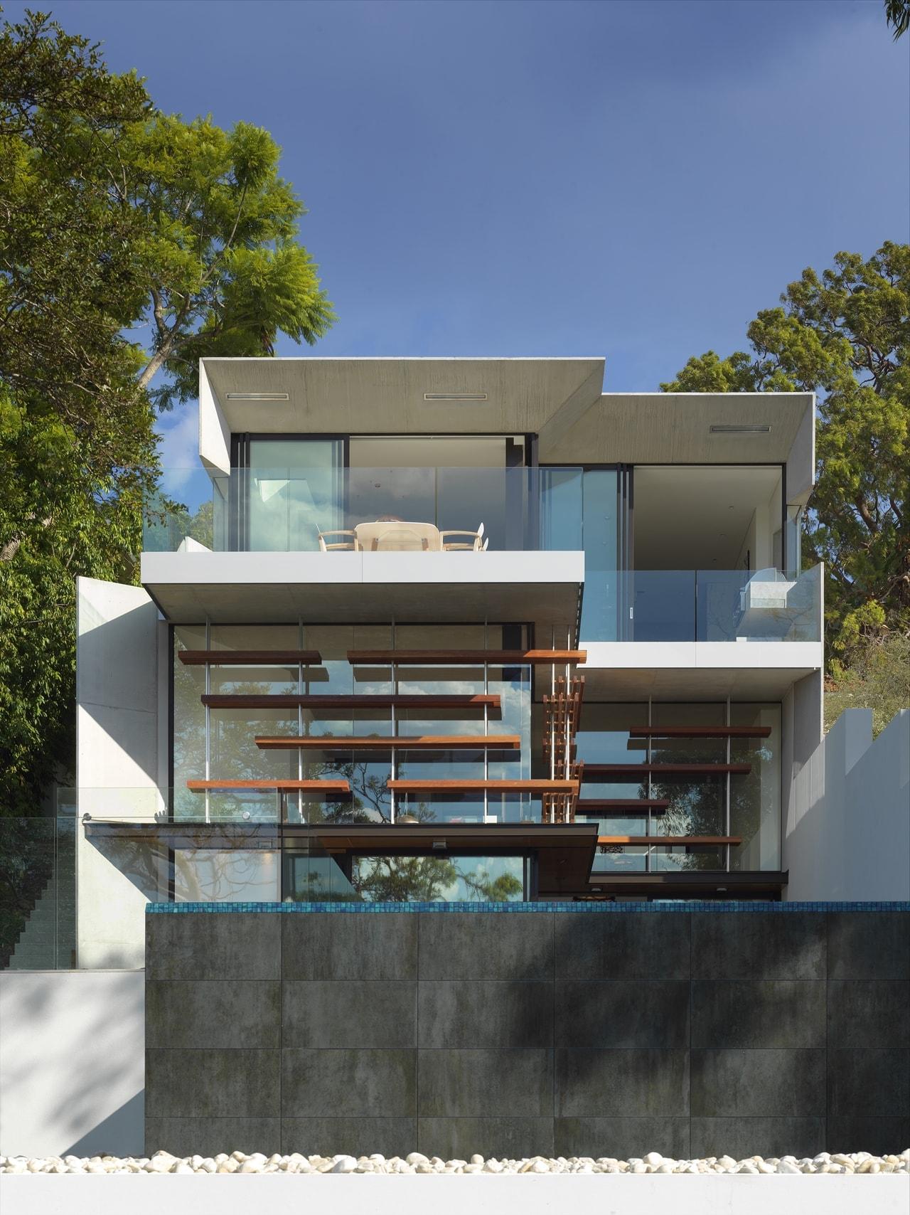 Luke butterly infinity edge pool in the hillside house designed by rolf ockert